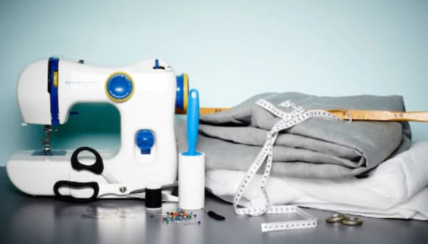 All you need to sew a soundproof curtain, including an IKEA sewing machine, fabric, measuring tape,, pins, scissors and cotton thread