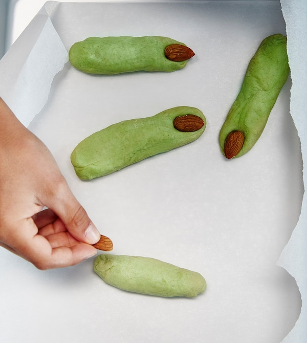 "Almonds are placed on shortbreads that look like witch fingers. The nuts are ""finger nails""."