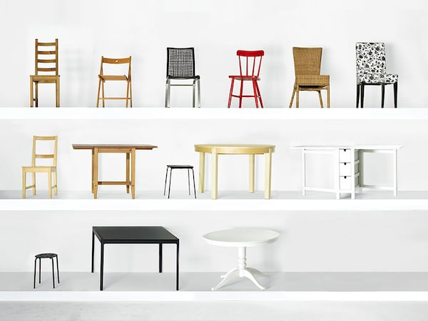 An assortment of IKEA Sell-Back program furniture products on display on white shelving.
