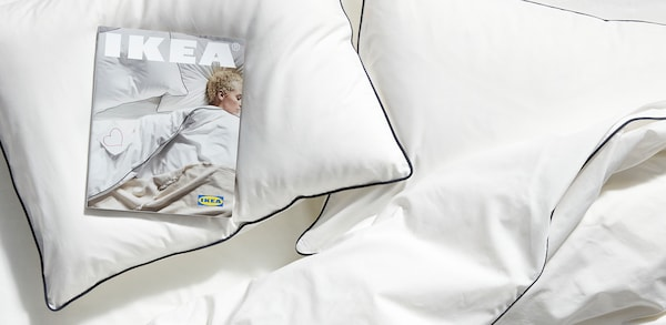 an IKEA 2020 catalog lying on a bed