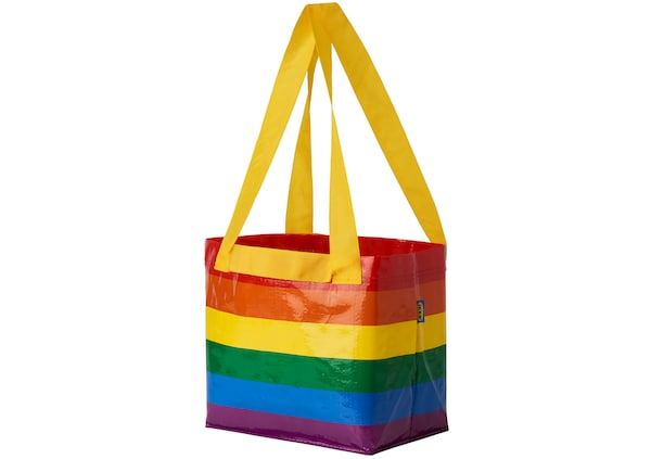 An IKEA bag with rainbow stripes and a yellow handle against a white background.