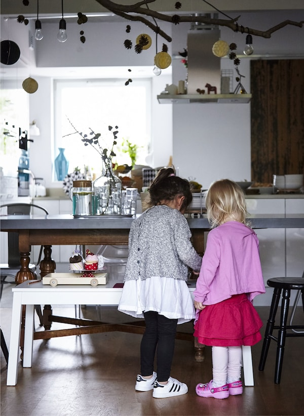 An IKEA bench makes a great pretend countertop for children to get hands-on in the kitchen or simply play alongside