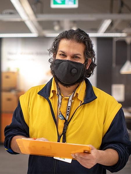 An IKEA co-worker assisting a customer