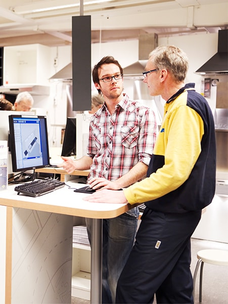 An IKEA co-worker assisting a customer