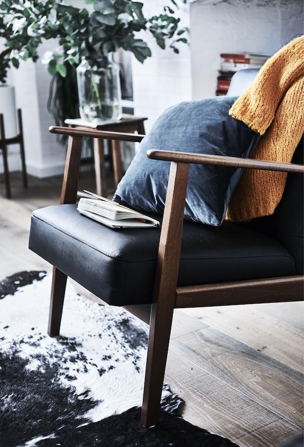 An IKEA EKENÄSET armchair.