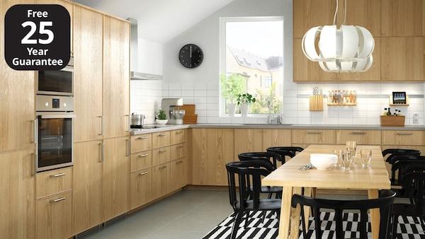 An IKEA EKESTAD kitchen with wooden worktop and metal, slimline handles.