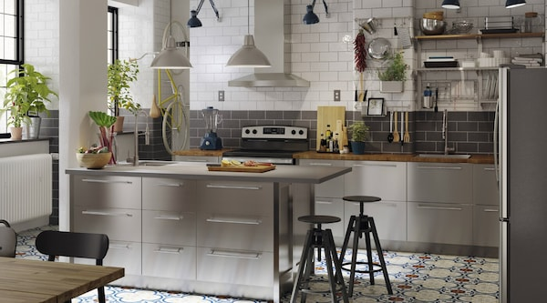 An IKEA kitchen with stainless steel cabinets.