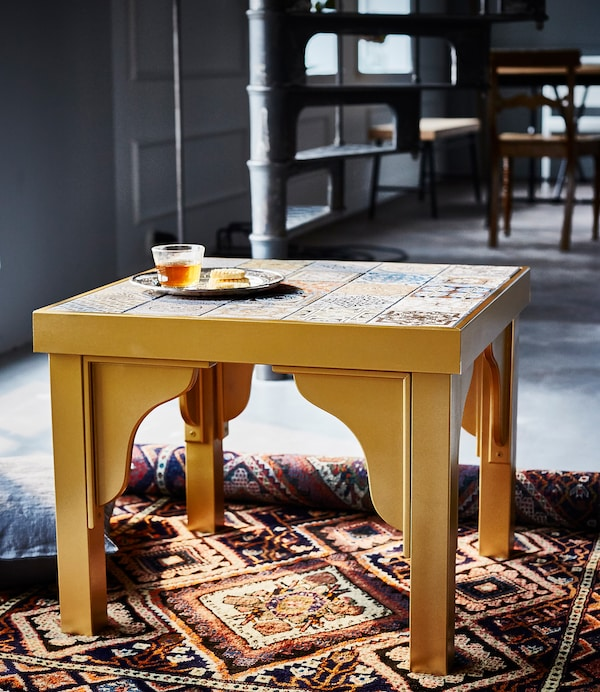 An IKEA LACK table has been hacked to have a Moroccan-inspired look. It's now gold and has tiles on the top.