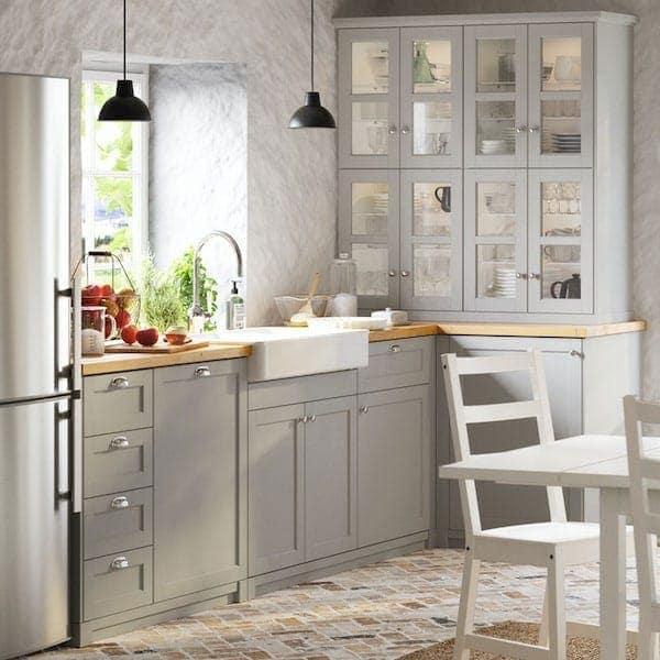 An IKEA LERHYTTAN light grey kitchen with oak worktop and metal handles.