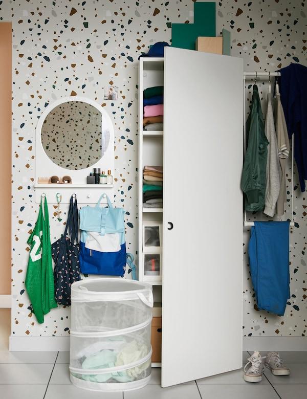 An IKEA PLATSA white wardrobe and a white mesh FYLLEN laundry basket in a teen bedroom.