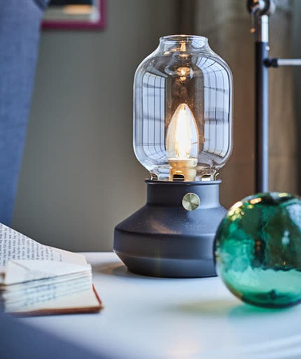 An IKEA TÄRNABY lantern designed table lamp.
