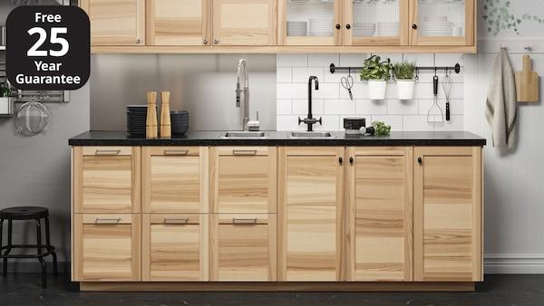 An IKEA TORHAMN kitchen with black worktop and black, slimline handles and door knobs.