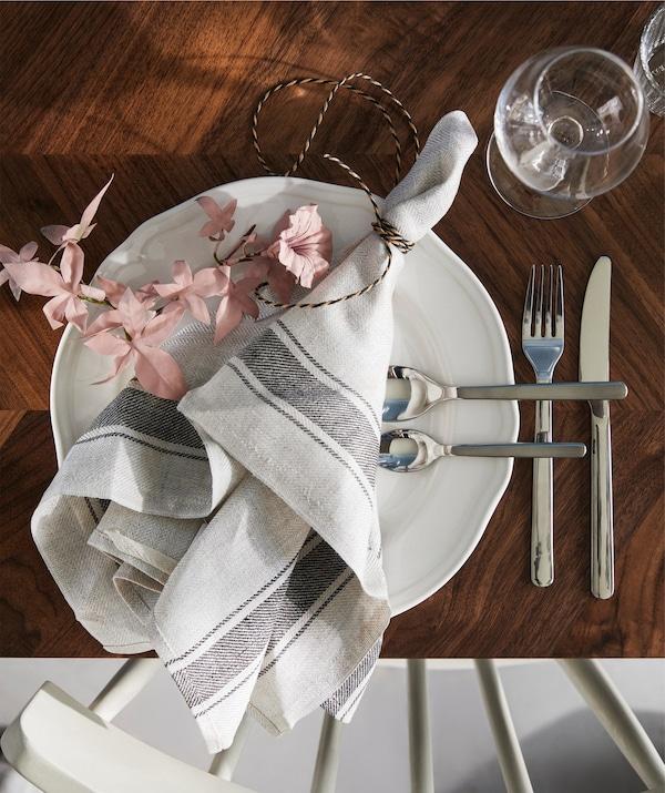 An IKEA VARDAGEN tea towel laying decoratively across a plate.