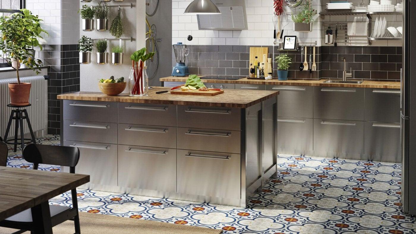 An IKEA VÅRSTA kitchen with island and wooden worktop.
