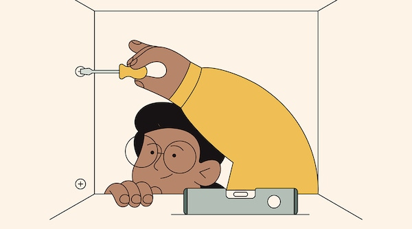 An illustration of a person installing an IKEA kitchen cabinet