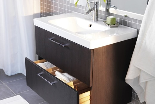 An image of a bathroom sink sitting on a 2 drawer cabinet