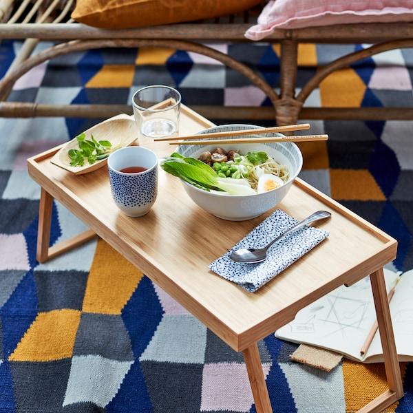 An image of ENTUSIASM mug, RESGODS bed tray and TARBAK rug.