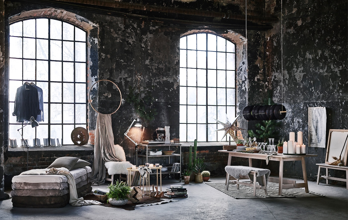 An industrial loft-style living room decorated for the holidays.