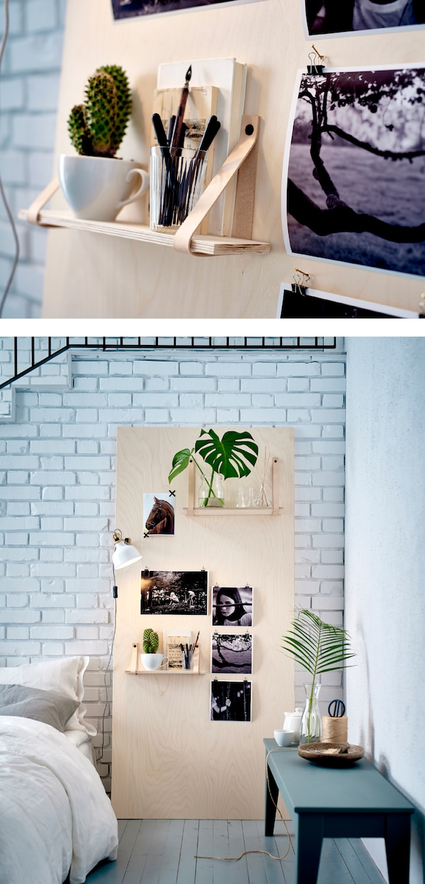 An inspiration board made of plywood leaning against a wall.