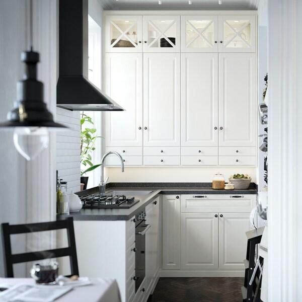 An off-white BODBYN kitchen in a corner