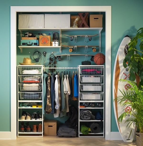 An open closet with JONAXEl storage solution storring clothes and accessories.