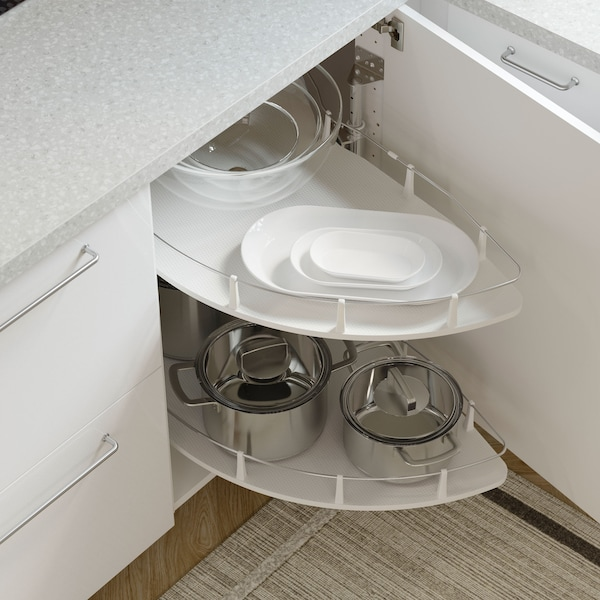 An open IKEA RINGHULT white kitchen cabinet front with a UTRUSTA carousel inside used for storing pots and pans.