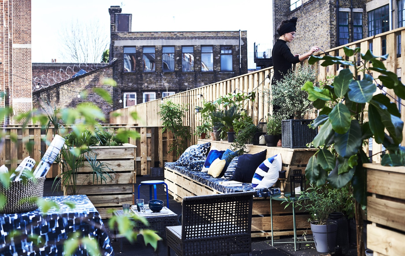 An outdoor terrace with textiles.