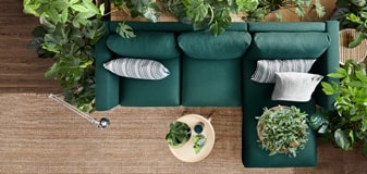 An over head view of a large green L-shaped couch