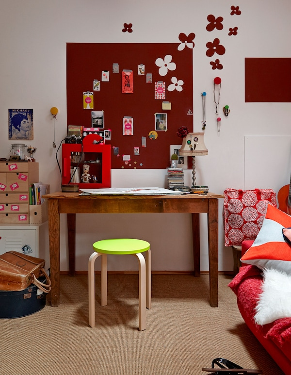 An overview of Lison's desk and workspace, including a red board with paper clippings arranged into a heart shape.