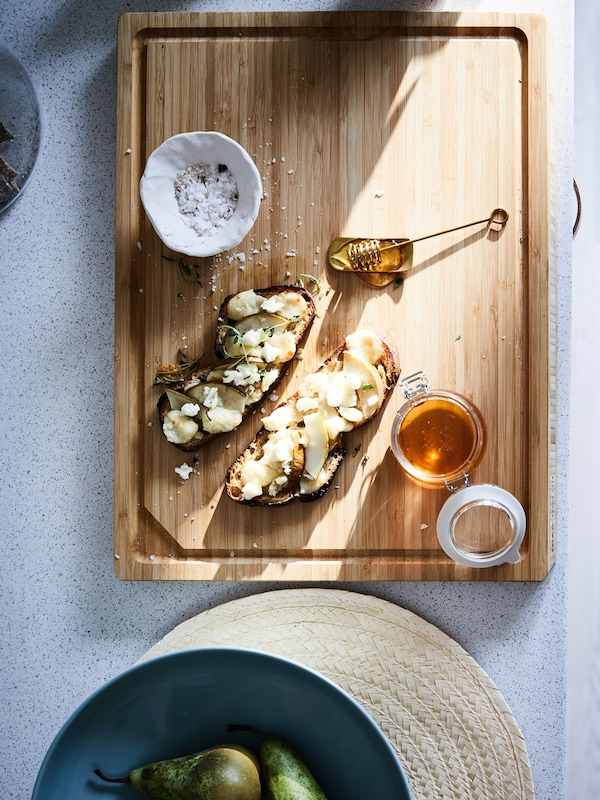 APTITLIG butcher block being used as serving board with baguette appetizer