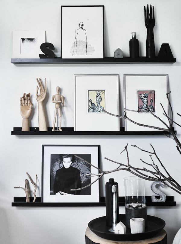 Artwork and objects displayed on picture rails.