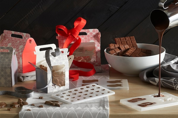 assortment of chocolates and chocolate molds on a table