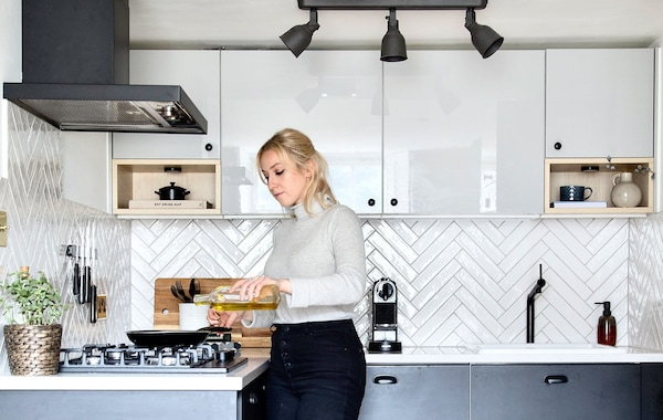 Athina from Topology Interiors cooking in her new IKEA kitchen