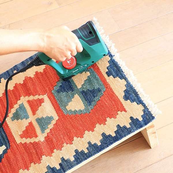 Attach the rug with a staple gun