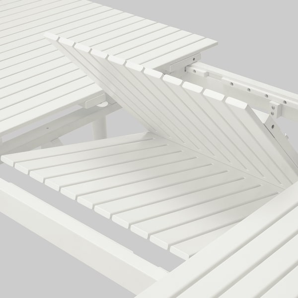 Ausziehfunktion des HATTHOLEM Esstischs in Weiß