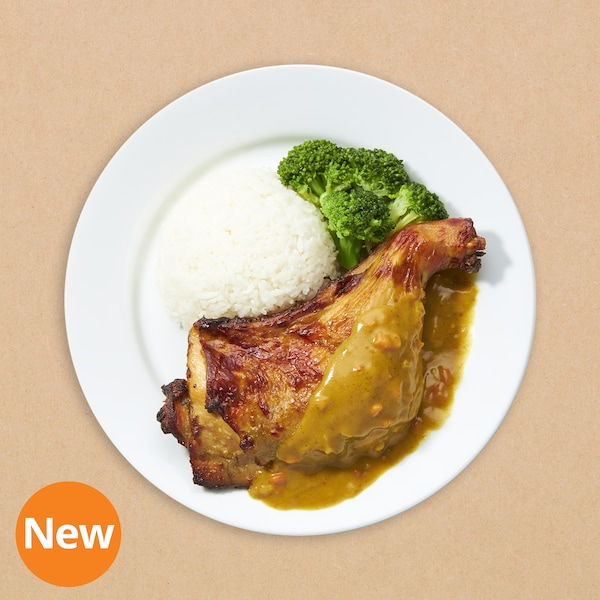 Baked chicken leg with rice and curry sauce