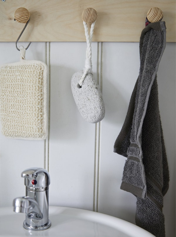 Bathroom accessories hanging on hooks.