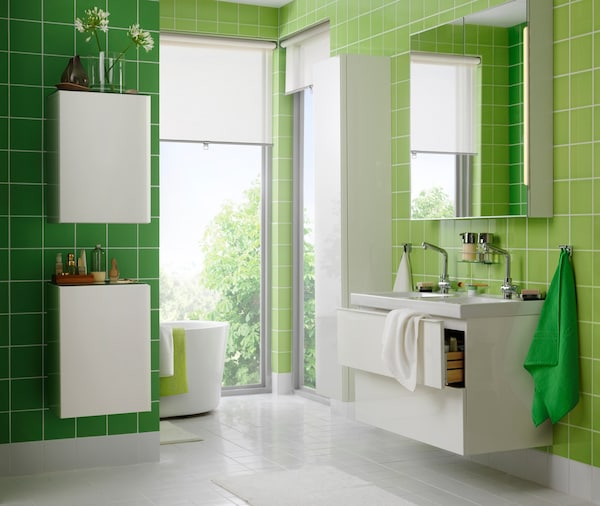 Bathroom with green walls consists of the GODMORGON series, which includes a vanity, mirror cabinet, and high cabinet.