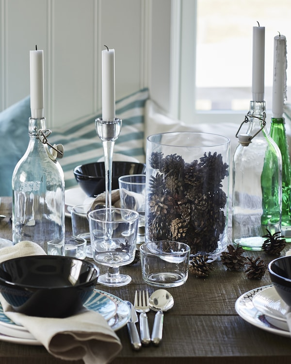 Be inspired by nature – cool winter shades and scattered pine cones help create the perfect seasonal table setting.