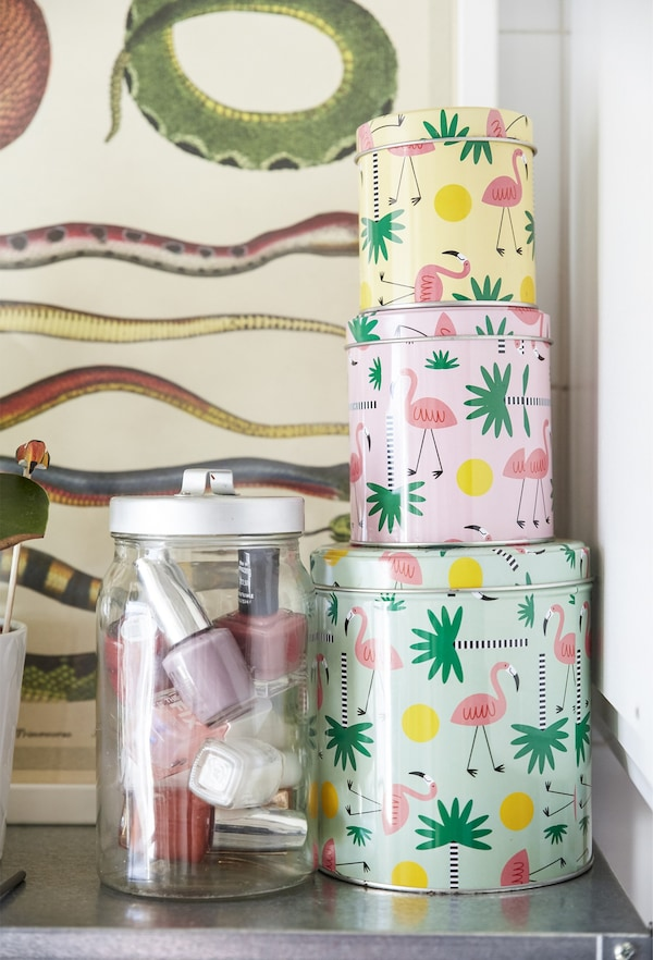 A stack of brightly patterned tins.