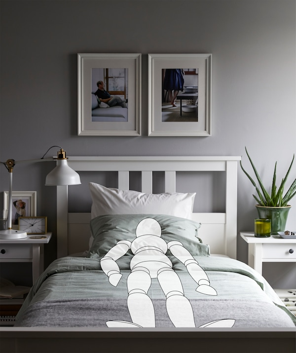 Bedroom interior with sketched person lying in a straight, symmetric position, echoed by the room's neat interior.