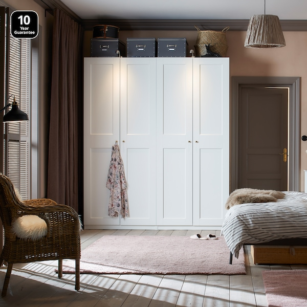 Bedroom showcasing a White PAX wardrobe with white Grimo doors
