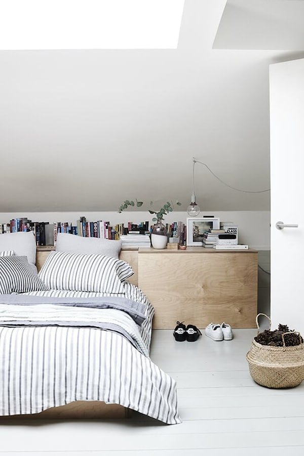 Bedroom with bed and wooden wall unit