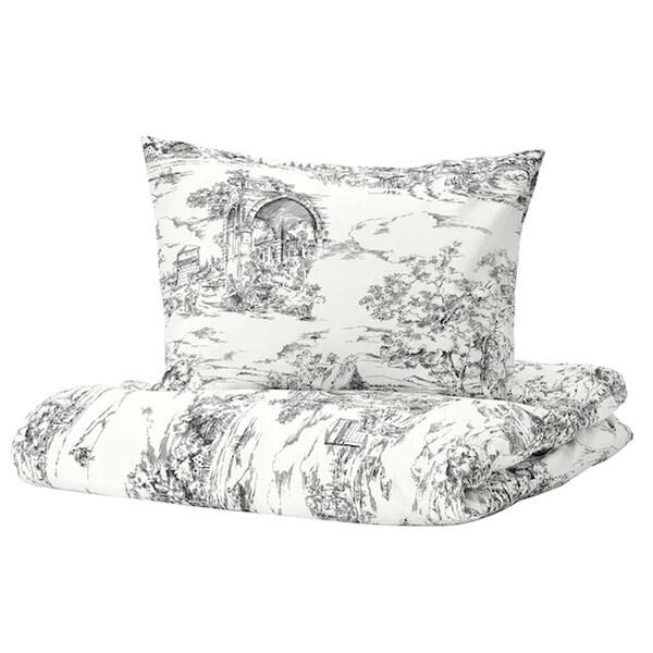 bilde av stjarnrams sengesett, hvitt og grått.