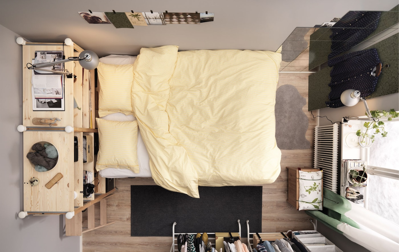 Bird's-eye view of a small bedroom for two with a platform bed and lots of storage.