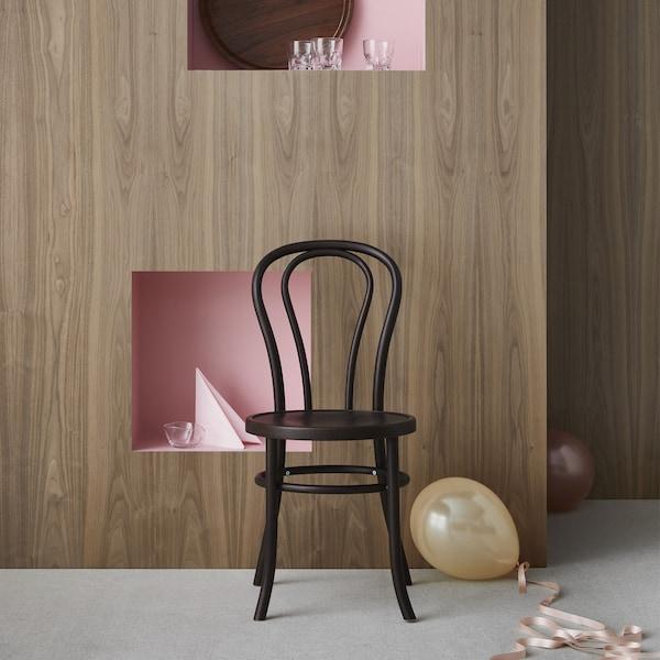 BJURÅN chair in black with balloons.