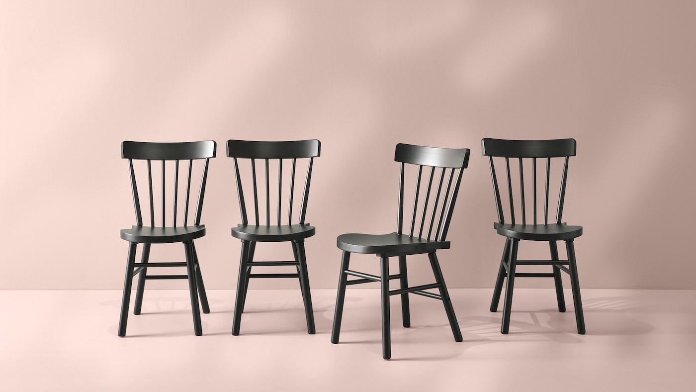 Black NORRARYD dining chairs placed in a row.