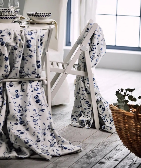 Blue and white fabric draped over TERJE chairs for a traditional wedding