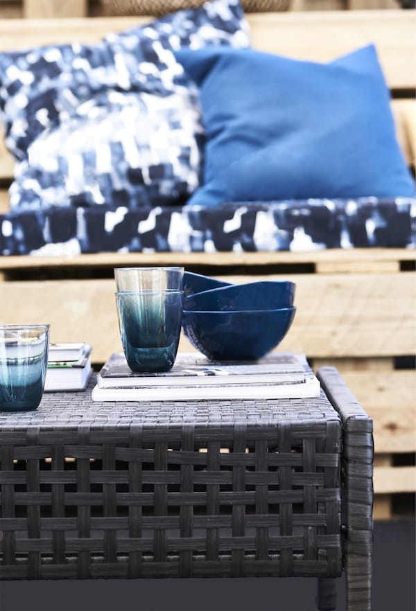Blue bowls on a weatherproof table.