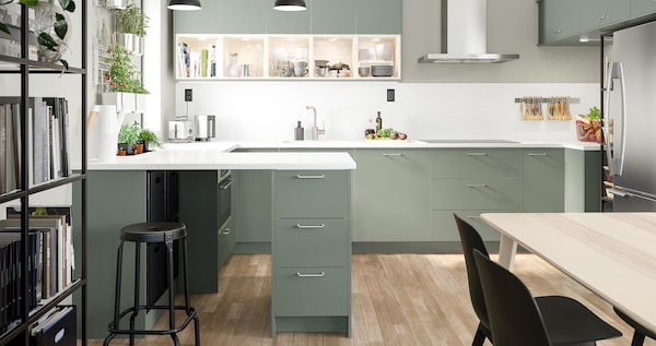 BODARP series in matte gray-green creates an open and welcoming kitchen with a modern twist.